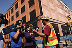 A construction worker speaks with members of the media after a Manhattan building collapse in New York, United States. 22/03/2012.  Photo by Kena Betancur / VIEWpress.
