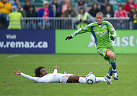 25 April 2010: Toronto FC midfielder Julian de Guzman #6 tries to slide tackle Seattle Sounders midfielder Osvaldo Alonso #6 during a game between the Seattle Sounders and Toronto FC at BMO Field in Toronto..Toronto FC won 2-0....