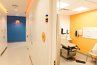 The new Diane Max Health Center of Planned Parenthood in Long Island City designed by architect Stephen Yablon. <br /> <br /> An exam room. Healthcare workers use a color coded system to communicate with each other about patients. <br /> <br /> <br /> Danny Ghitis for The New York Times