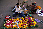 Asia, India, Orcha. Vendor sells marigolds outside temple in Orcha.