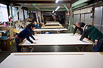 Artisans check washi paper produced at Iwano Heizaburo Seijijo in Echizen, Fukui Prefecture, Japan on 21 Feb. 2013. Photographer: Robert Gilhooly