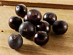 Photos &amp; pictures of the acai berries the super fruit anti oxident from the Amazon. The acai berry has been associated with helping weight loss. Stockfotos &amp; images