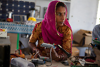 Indian student Riju Kawanr, aged 35, from Chandulaw village in Jodhpur, Rajasthan, has been studying solar engineering in the Barefoot College in Tilonia village, Ajmer, Rajasthan, India for the last 4 months and will be leave after completing 6 months to start her practice in her village of origin. Photo by Suzanne Lee for Panos London