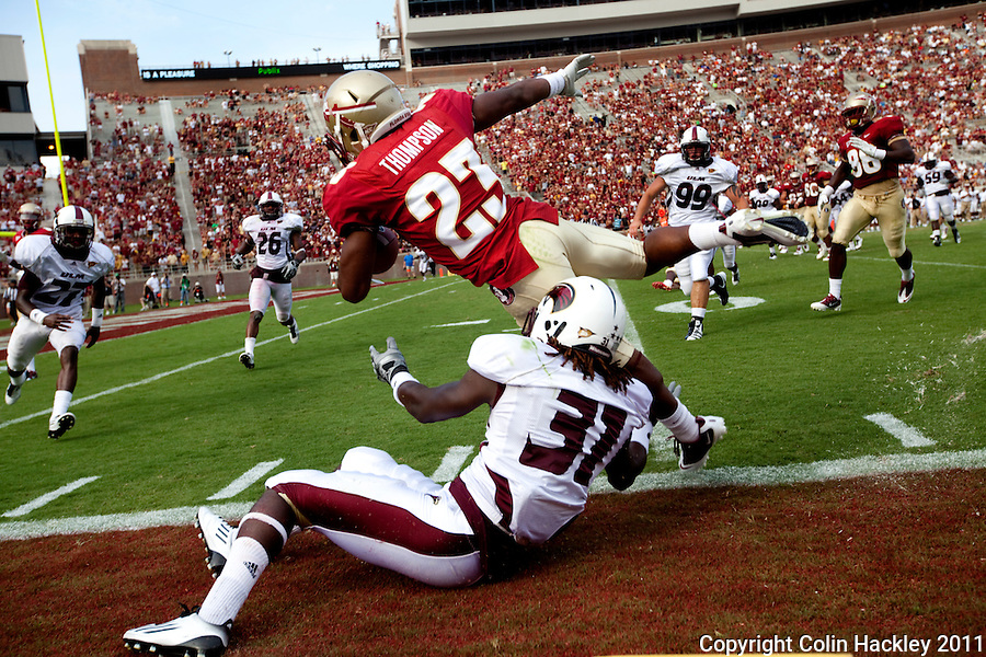 TALLAHASSEE, FL 9/3/11-FSU-ULM FB090311 CH-Florida State's Chris Thompson is snagged by University of Louisiana at Monroe Henry Mitchell during second half action Saturday at Doak Campbell Stadium in Tallahassee. The Seminole's beat the Warhawks 34-0. .COLIN HACKLEY PHOTO