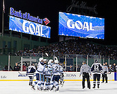 The Maine Black Bears celebrate Mark Anthoine's (Maine - 24) goal. - The University of Maine Black Bears defeated the University of New Hampshire Wildcats 5-4 in overtime on Saturday, January 7, 2012, at Fenway Park in Boston, Massachusetts.