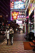 Pedestrians walks past a store selling the luxury watches in Central Macau, China.
