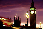 Big Ben, Parliament and a double decker bus at dusk in London, United Kingdom