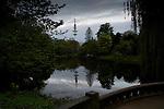 Telecommunications tower reflected in a lake at dawn.Hamburg, Germany