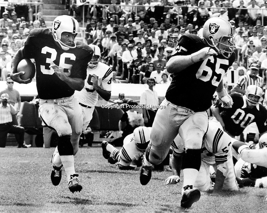 Raider runing back Clem Daniels follows Wayne Hawkins around right end, 1967. Photo by Ron Riesterer