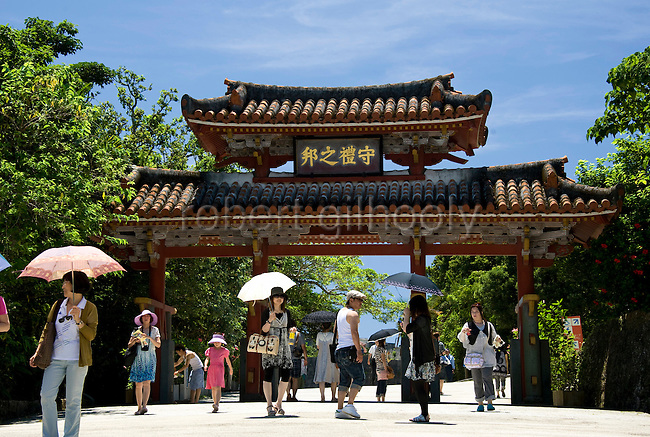 """Photo shows Shureimon Gate inside the grounds of Shuri-jo Castle park in Naha, Okinawa Prefecture, Japan, on May 28, 2012. Shureimon was built during the reign of King Sho Sei, 1527-1555 and the placard at the top of the gate reads """"A Land of Prosperity."""""""
