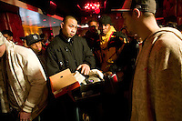 A man shows the sneakers he has brought to sell or trade the pair during Dunkxchange, a market held in a club in New York City, USA, where sneaker collectors trade and sell their rare shoes, 7 January 2007.<br />