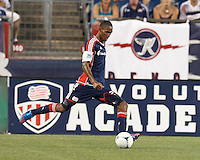 New England Revolution substitute forward Jerry Bengtson (27) crosses the ball. In a Major League Soccer (MLS) match, New England Revolution defeated New York Red Bulls, 2-0, at Gillette Stadium on July 8, 2012.