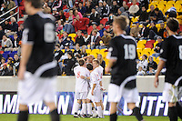 Tristan Watson (22) of the Cincinnati Bearcats celebrates scoring a goal with teammates. The Providence Friars defeated the Cincinnati Bearcats 2-1 during the semi-finals of the Big East Men's Soccer Championship at Red Bull Arena in Harrison, NJ, on November 12, 2010.