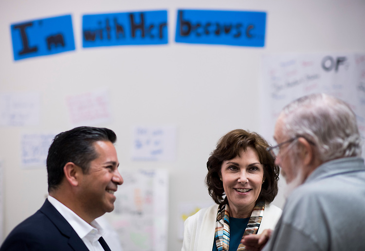 UNITED STATES - OCTOBER 18: From left, DCCC Chairman Ben Ray Luján, D-N.M., and Jacky Rosen, Democratic candidate for Nevada's 3rd Congressional district, speak with campaign volunteers in the Nevada Democrats'  field office in southwest Las Vegas on Oct. 18, 2016. (Photo By Bill Clark/CQ Roll Call)