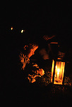 Brandon Hayes watches the flickering flame from a lantern after a Civil War re-enactment for the the Battle of Fort Morgan, Mobile, Al in 2001. Jim Bryant Photo. @2001. All Rights Reserved.