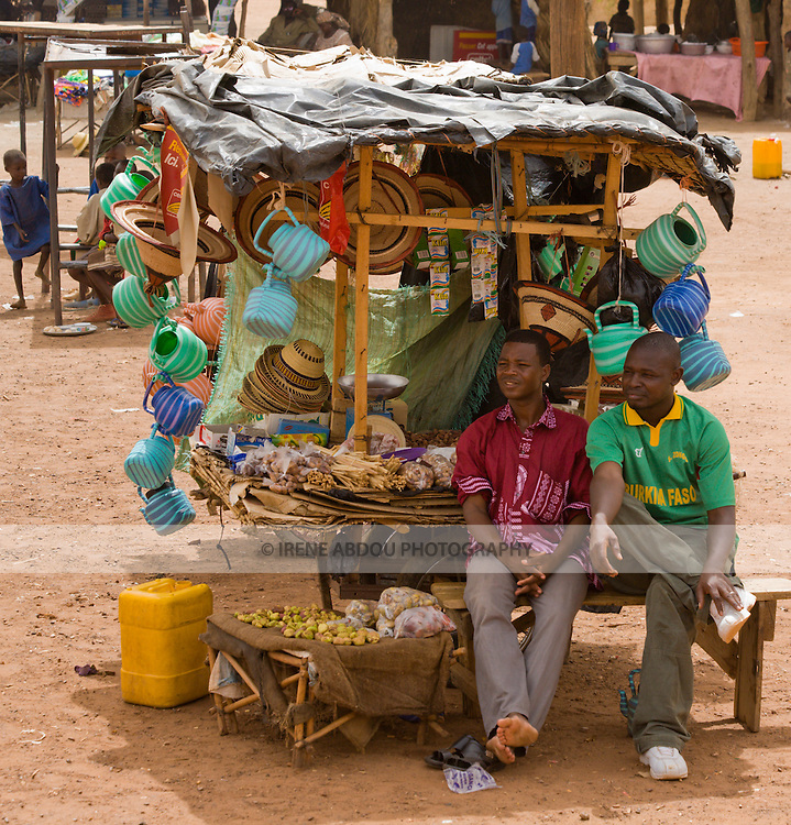 Two men sit at a kiosk at the customs stop in Torodi, Niger.