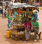 Two men sit at a kiosk at the customs stop in Torodi, Niger.