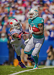 14 September 2014: Miami Dolphins wide receiver Jarvis Landry returns a kickoff against the Buffalo Bills in the third quarter at Ralph Wilson Stadium in Orchard Park, NY. The Bills defeated the Dolphins 29-10 to win their home opener and start the season with a 2-0 record. Mandatory Credit: Ed Wolfstein Photo *** RAW (NEF) Image File Available ***
