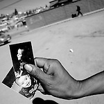 A migrant from Honduras shows photos of his American son in Nogales, Sonora, Mexico, on Friday, Feb. 1, 2008. The man lived in Tennessee for years but was unable to begin the citizenship process by marrying his girlfriend because Tennessee does not recognize marriages by undocumented migrants.