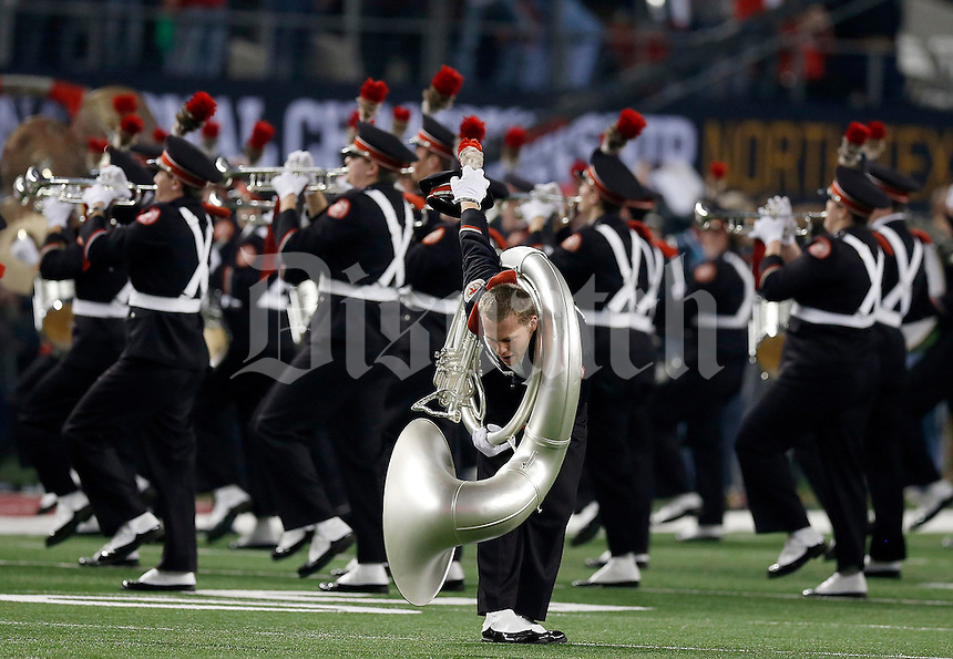 """Band member Justin Pitts dots the """"i"""" before the College Football Playoff National Championship at AT&T Stadium in Arlington, TX on Monday, January 12, 2015. (Columbus Dispatch photo by Jonathan Quilter)"""