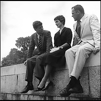 BNPS.co.uk (01202 558833)<br /> Pic: Bonhams/BNPS<br /> <br /> Jack and Jackie meet a collegue and stop for a chat on a wall on Capitol Hill.<br /> <br /> Fascinating photographs of the Kennedys during their first year of marriage have emerged for auction.<br /> <br /> The intimate snaps of the future US president and his wife Jackie were taken by renowned photographer Orlando Suero who spent five days with the couple at their Georgetown home in May 1954.<br /> <br /> At the time, Kennedy was a young senator from Massachusetts establishing himself as one to watch on the US political scene.<br /> <br /> The collection's owner, Max Lowenherz, donated the bulk of the photographs and negatives to the Peabody Institute of Johns Hopkins University in Maryland, USA.<br /> <br /> He has now decided to put 31 of them up for auction and they are tipped to sell for &pound;4,900 ($6,000).