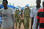 In their trademark blue helmets and wearing face masks to ward off disease, United Nations soldiers patrol a camp for internally displaced families located inside a UN base in Juba, South Sudan. The camp holds Nuer families who took refuge there in December 2013 after a political dispute within the country's ruling party quickly fractured the young nation along ethnic and tribal lines. The ACT Alliance is providing a variety of services, including fresh water, sanitation and refuse collection services, to the more than 20,000 people living in the camp.