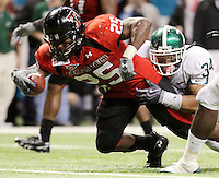 Texas Tech's Baron Batch, left, runs in for a touchdown and is tackled by MSU's Brandon Denson during the second half of the Valero Alamo Bowl, Saturday, Jan. 2, 2010, at the Alamodome in San Antonio. Texas Tech won 41-31. (Darren Abate/pressphotointl.com)