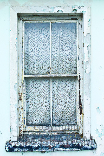 Lace curtains in typical window in Ennistymon ( Ennistimon), County Clare, West of Ireland