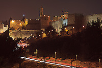 Night traffic on Hativat Yerushalayim and Jaffa Street passes the Sultan's Pool and Citadel of David on the way to the Jaffa Gate in Jerusalem's Old City.