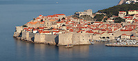 The medieval walled city, with the defensive walls and the old harbour, protected by the 14th century Fortress of St John or Mulo Tower, Dubrovnik, Croatia. The city developed as an important port in the 15th and 16th centuries and has had a multicultural history, allied to the Romans, Ostrogoths, Byzantines, Ancona, Hungary and the Ottomans. In 1979 the city was listed as a UNESCO World Heritage Site. Picture by Manuel Cohen