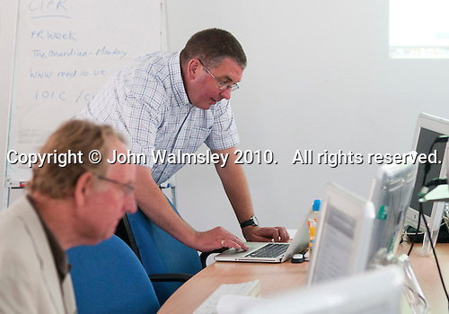 Journalists learning extra skills (setting up a website) at the National Union of Journalists training centre, London.