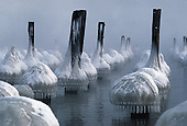 Ice covered pilings in Lake Superior. They are the remains of an old dock in Marquette, Michigan.