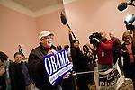Sunday December 10th, 2006,  Portsmouth, New Hampshire.Jack Ford, of Hampton, NH, shows off his Obama sign from the 2004 Democratic National Convention..Illinois Senator Barack Obama visited Portsmouth, New Hampshire today to sign his new book and speak a message of hope to his assembled supporters who helped him sell out two packed convention halls. . He signed books and visited a local coffee shop on his way to Manchester for a New Hampshire Democratic Party fund raiser.<br />