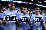 """05 January 2015: UNC students honor the late ESPN broadcaster and UNC alumnus Stuart Scott with """"STU"""" signs. The University of North Carolina Tar Heels played the University of Notre Dame Fighting Irish in an NCAA Division I Men's basketball game at the Dean E. Smith Center in Chapel Hill, North Carolina."""