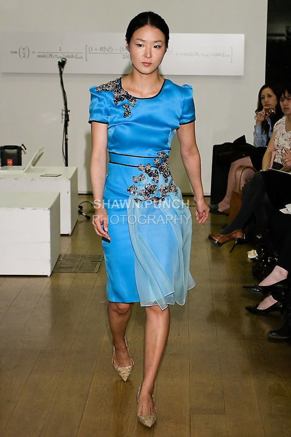 85 Broads member walks runway in an outfit by Yuna Yang, during the 85 Broads Presents Yuna Yang trunk show at Art Gate Gallery on October 24th 2011.
