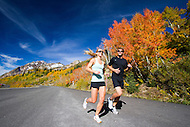 Male and Female joggers enjoy the fall colors in Little Cottonwood Canyon, Utah