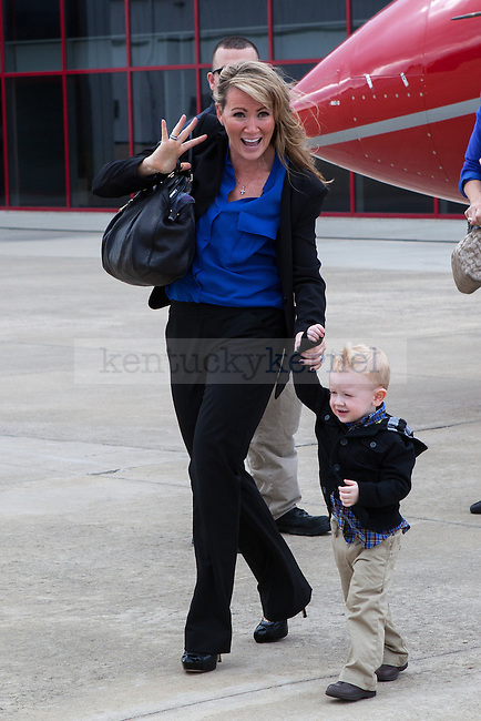New University of Kentucky head football coach Mark Stoops' wife Chantel, with their youngest son Will, stepping off his plane at the R.J. Corman Hanger in Nicholasville, Ky on December 2, 2012. Photo by Adam Chaffins | Staff