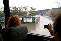 12 March 2006 - New Jersey, USA - Participants in a bus tour of locations featured in the hit television mob show The Sopranos look out at a waste management site in New Jersey, USA, known as Barone Sanitation in the series, 12 March 2006.