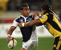 Hurricanes second five Ma'a Nonu tackles Taniela Moa during the Super 14 rugby union match between the Hurricanes and Blues at Westpac Stadium, Wellington, New Zealand on Friday 1 May 2009. Photo: Dave Lintott / lintottphoto.co.nz
