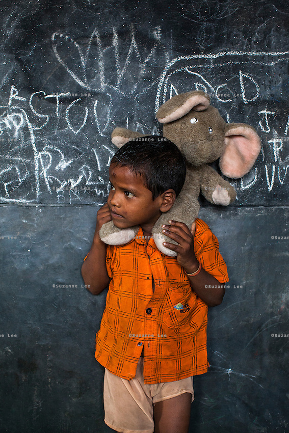 Sahil, 4, poses for a portrait with a soft toy in the Guria Non-Formal Education center in the middle of the Shivdaspur red light district, Varanasi, Uttar Pradesh, India on 20 November 2013. Guria uses the soft toys as a form of therapy for the children of the women in prostitution and also use it as signals of the children's emotional wellbeing.