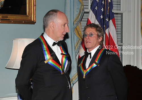 Washington, DC - December 6, 2008 -- Pete Townshend, left, and Roger Daltrey, right, share some thoughts after posing for the formal group photo following the Artist's Dinner at the United States Department of State in Washington, D.C. on Saturday, December 6, 2008 to honor 2008 recipients of the Kennedy Center Honors..Credit: Ron Sachs - Pool via CNP