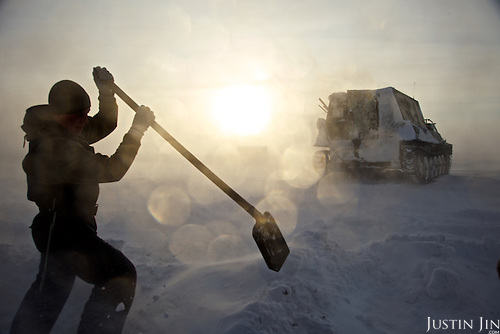 "Workers dig snow in the colony set up by oil and gas prospecting company ""Siesmorevzedka"" in the Arctic tundra. Typically, they work in the cold, isolated Arctic tundra for the entire winter, returning to civilisation only in spring."