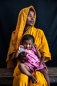 Sarita Devi poses for a portrait with her 18 month daughter, Usha Kumari Mandal at the government health centre in Hanuman Nagar in Saptari, Nepal.