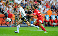 Kerstin Garefrekes (l) of Germany and Marie-Eve Nault of Canada during the FIFA Women's World Cup at the FIFA Stadium in Berlin, Germany on June 26th, 2011.