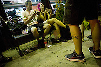 30 June 2005 - Brooklyn, NY, USA - Riders chat outside a coffe shop in Brooklyn, USA, June 30th 2005, on the first evening of the 13th annual cycle messenger world championships. More than 700 riders from all over the world took part in the 4-day competition which carries event based on the daily work of a city bike messenger. Photo Credit: David Brabyn/Sipa Press