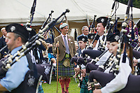 The Duke of Argyll, Torquhil Campbell, watches pipers at the Inveraray Highland Games, which are held at the Duke's home, Inveraray Castle in Argyll.