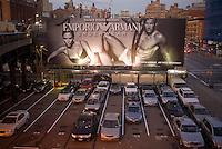 A billboard for Emporio Armani featuring underwear clad David and Victoria Beckham is seen from the new High Line Park in the New York neighborhood of Chelsea on Thursday, October 22, 2009.  (© Richard B. Levine)