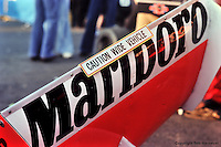 HEUSDEN-ZOLDER - MAY 16: Following a technical dispute at the previous race, Team McLaren posted this sign on the rear wing of the McLaren M23/Ford Cosworth before practice for the Grand Prix of Belgium on May 16, 1976, at Circuit Zolder near Heusden-Zolder, Belgium.