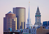 Architecture icons of Boston's North End and Financial district. Modern office building rise behind the steeple of the Old North Church and clock tower of the Customs House. Boston, MA.