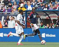 New England Revolution forward Saer Sene (39) dribbles down the wing.  In a Major League Soccer (MLS) match, the New England Revolution (blue/white) tied Vancouver Whitecaps FC (white), 0-0, at Gillette Stadium on March 22, 2014.